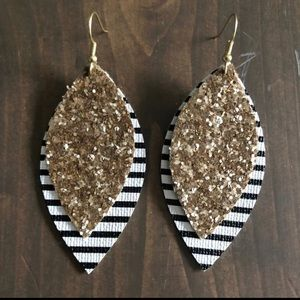 Brand new!!!  Faux leather glitter stripe earrings